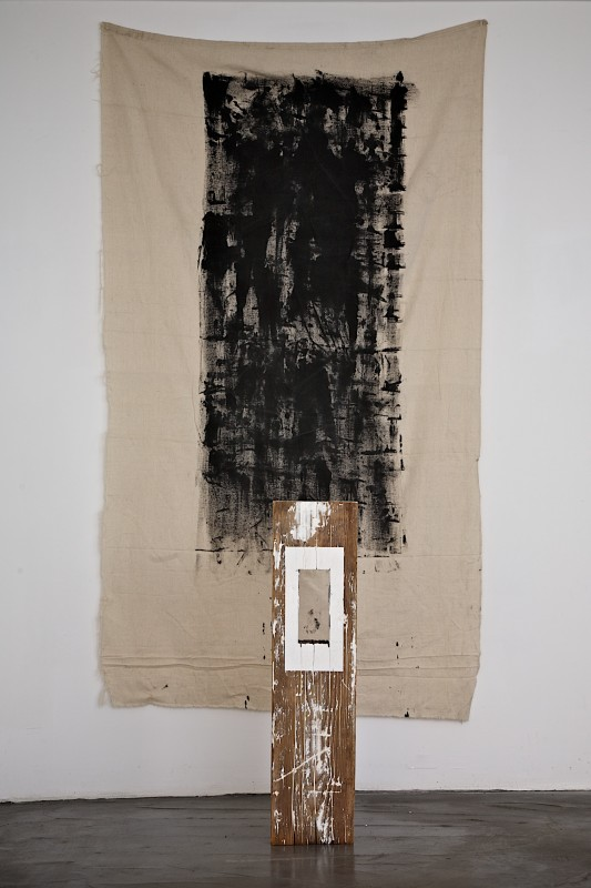 Found wooden object, spackle, staples, and primer – 8 x 2.75 x 31 inches. Dropcloth and black acrylic – 75 x 41 inches. 2013